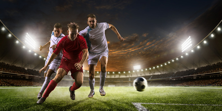 50612731 - soccer players in action on the sunset stadium background panorama