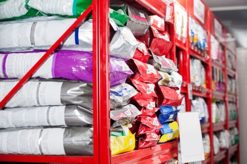 60664291 - pet food packets arranged on shelves at store