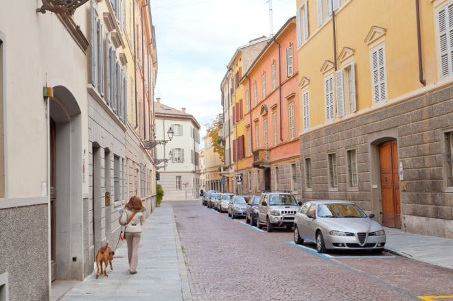 16799673 - picturesque street in parma, italy in autumn day,