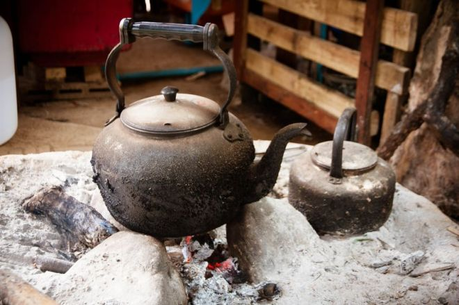 17664627 - black kettle on charcoal