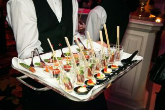 46512615 - server holding a tray of appetizers at a banquet